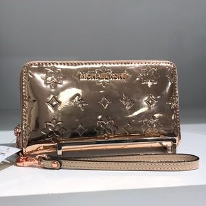 Michael Kors Rose gold metallic flat phone wallet